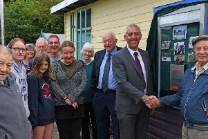 Hunloke Community Garden:  Peter Openshaw is shaking hands with Hardyal Dhindsa.  Then from (L/R front row) Paul Nicholls, Kelly-Louise Stevens, Grace, Lisa Blakemore and local County Councillor Dave Allen. (L/R back row) Margaret Kenny, Roger Wilcockson, Bob Wilson and Jude Cornwell.