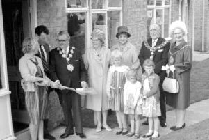 Special presentation: Not the same picture as last week ' its slightly different because it shows not only Alfred and Alice Lockwood receiving the keys to their new home in Foxroyd Lane, Thornhill, but also three of their four children, Ann, Jane and Margaret.