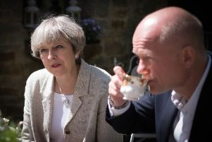 Prime Minister Theresa May and former Foreign Secretary William Hague during a visit to Pot House Hamlet, during a General Election campaign visit to Yorkshire