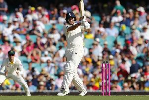 England's Joe Root pulls through mid-wicket on day one at the SCG. Picture: Jason O'Brien/PA