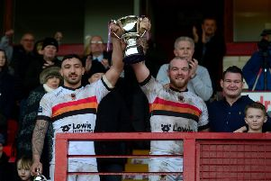 Bradford Bulls pair Elliott Minchella, left, and Steven Crossley, with the Yorkshire Cup.