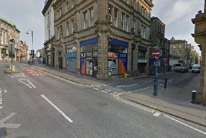 West Yorkshire Police are today appealing for information regarding an armed robbery in Huddersfield last month which took place on Wood Street at the junction with Kirkgate, pictured.
