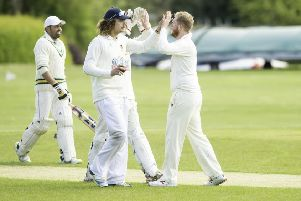 Teammates congratulate Ossett bowler Joe Finnigan after taking a wicket during last week's Bradford League Championship One game at East Bierley. Picture: Allan McKenzie