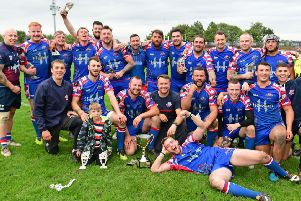 Ossett Trinity held off a late fight back by Thornhill Trojans to win the John Kane Cup.