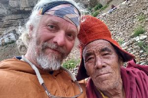 Darren Clarkson-King in Bhutan. Below: Meeting the locals on his travels.