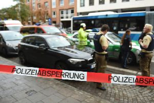 Police carry out inquiries after the attack in Munich. Photo: Andreas Gebert/dpa via AP