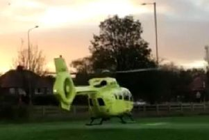 The helicopter takes off.