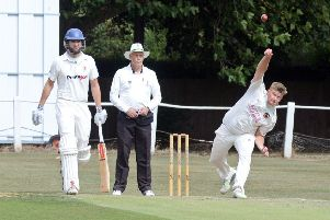 Ben Sommerville is pictured bowling for Conisbrough as Tickhill's Michael Jepps watches on. Photos: Marie Caley