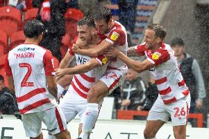 Rovers' players celebrate Ben Whiteman's winning goal against Luton Town.