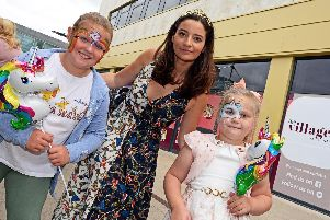 Apprentice Star and local business woman Fran Bishop pictured with Jessica Shorthouse, eight, of Intake and Mia Heath, six, of Carcroft, during the Free Family fun day she organised at Waterdale. Picture: Marie Caley