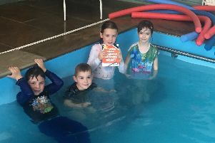 Little swimmers raise a pool of cash for local charity