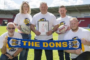 Chris Dungworth (Business Doncaster), Lorna Reeve (visit Doncaster), Carl Hall (Doncaster RLFC), Dean Wiffen (Doncaster council), Ben Lewis (keepmoat stadium) with the Rugby League World Cup bid. PIcture: Dean Atkins