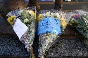Flowers placed outside Cardiff City Stadium.