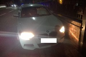 The BMW which was pursued by police before crashing into another vehicle