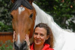 Anita and her horse April staying safe from horse flu