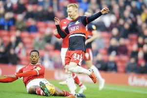 Ali Crawford is tackled by Barnsley's Ethan Pinnock in the previous meeting at Oakwell