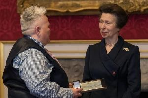 Alison Collins receiving her award from The Princess Royal, Princess Anne