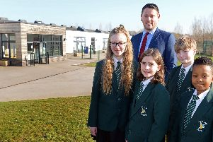 Richard Tuddenham, Carr Lodge Academy Headteacher, pictured with year six children l-r Lily Webster, 11, Eliza Andrianova, ten, Charlie Normansell, 11 and Blessing Dzapasi, 11. Picture: Marie Caley NDFP-26-02-19-CarrLodge-3