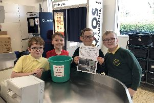 Primary school pupils at Edenthorpe pack bags to raise funds for a play park