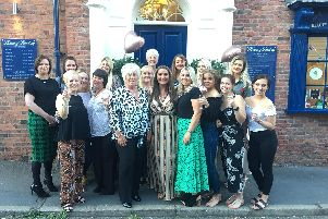 Lisa Lawson (centre) pictured with past and present staff