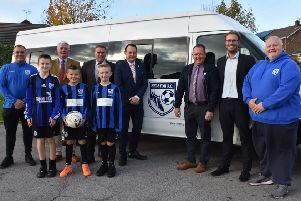 Selston Football Club officials and young players with the new team bus and representatives from Ashfield District Council.