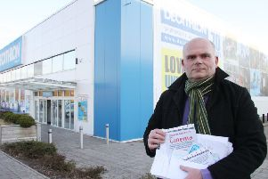 Coun Richard Robinson collecting signatures for a cinema petition in 2013.