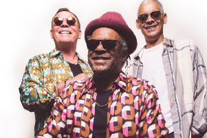 From left, Ali Campbell, Astro and Mickey Virtue play Sherwood Pines on Sunday.