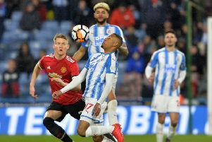 Rajiv van La Parra holds the ball frm Scott McTominay.' Huddersfield Town v Manchester United.  Emirates FA Cup 5th Round.  John Smiths Stadium. '17 February 2018.  Picture Bruce Rollinson