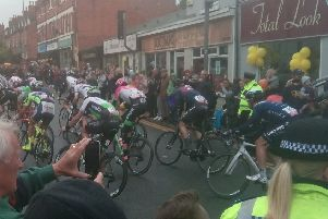 Tour of Britain riders hurtle down Hucknall High Street.