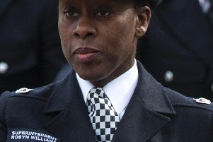 Superintendent Robyn Williams leads new recruits to the Metropolitan Police Service during their 'Passing Out Parade' in 2015. Photo - Rob Stothard/Getty Images
