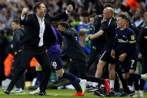 Derby celebrate at the end of the game.