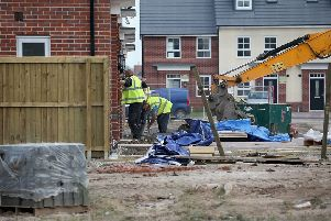 Construction workers build new houses on a housing development. Photo by Christopher Furlong/Getty Images.