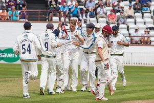 Steve Patterson is congratulated for taking the wicket of Andrew Hildreth on day two. Picture: John Heald