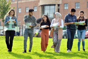 Juliana Kalniana, A*, Yusuf Khan, 9A*, Hansa Khan, 8A*, Iqra Hussain, 9A*, Arman Khan, 9A* and Alex Funk 9A* looking at their results at Dixons Trinity Academy, Bradford. Picture Bruce Rollinson