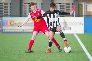 Scarborough Athletic Under-16s Lewis McGrath tries to win the ball back for his side ''''                Pictures by Andy Standing