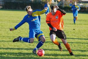 Falsgrave, blue and yellow kit, take on Snainton