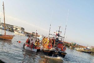 Crews assisting the boat. PIC: HM Bridlington Coastguard.