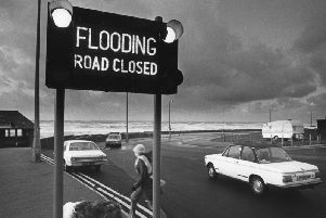 One photo shows Princes Way at Little Bispham leading to the seafront and new technology is noted. The flooding road-closed sign is described on the back of the photo as a motorway type warning. It was taken in November 1982.