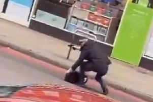 Screengrab from video taken with permission from the Twitter feed of @gullyyt of an armed police officer on Streatham High Road (Picture: Gully/PA Wire)