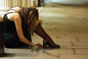A woman drinker slumps on the pavement in a 2005 file photograph (Picture: Matt Cardy/Getty Images)