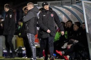 Fleetwood boss Joey Barton leaves the dugout after his red card at Wycombe