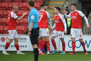 Fleetwood Town's Callum Connolly celebrates scoring his side's first goal with team-mates