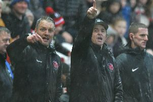 Joey Barton (right) and assistant Clint Hill point the way forward for Fleetwood Picture: PHILL HEYWOOD