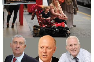 Sir Lindsay Hoyle, Chris Grayling and Gordon Marsden MP. Main picture, a traveller waits for a train. Inset, the departures board shows more delays