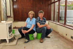 Paula and Stephen Simpson in their empty home, which is at the centre of a dispute with insurers