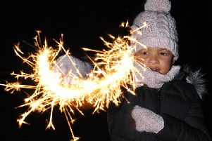 Alyssia Onwuyali with a sparkler at Kirkham Cricket Club
