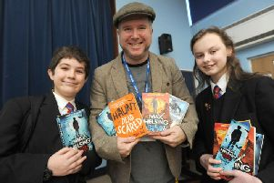Author and illustrator Curtis Jobling pays a visit to pupils at Cardinal Allen and Baines.  He is pictured with Cardinal Allen pupils Kaid Dervishaj and Jennifer Beaumont.
