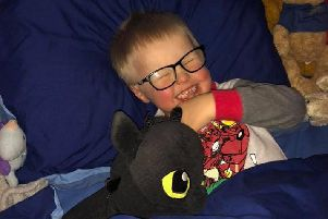 Freddie snuggles with Toothless