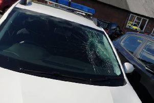 Damage to the patrol cars.
