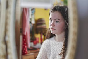 The NSPCC had more than 700 calls and emails from people in the north west concerned about children being left home alone (Picture posed by model)
